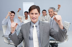 Business team celebrating a sucess with hands up stock photos