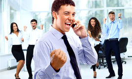 Business team celebrating a triumph Royalty Free Stock Images