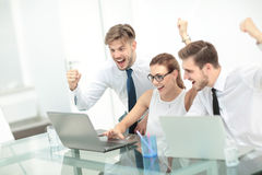 Business team celebrating a triumph with arms up Stock Images