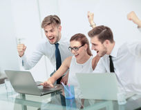 Business team celebrating a triumph with arms up Stock Photography