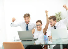 Business team celebrating a triumph with arms up Royalty Free Stock Image