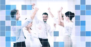 Business team celebrating victory in office. Business, people, achievement and success concept - happy business team celebrating victory in office over blue Royalty Free Stock Photos
