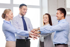 Business team celebrating victory in office. Success, business, office and winning concept - happy business team celebrating victory in office Royalty Free Stock Photos
