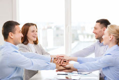 Business team celebrating victory in office Stock Photos