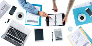 Business team checking appointment schedules Royalty Free Stock Photos