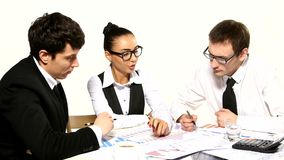 Business team cheerfully talking. Girl showing stock footage