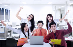 Business team cheering for success at office Stock Image