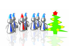 Business team and christmass tree. Business team with leader in santa hats and christmass tree Royalty Free Stock Photos