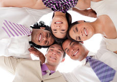 Business team in a circle with heads together Royalty Free Stock Images