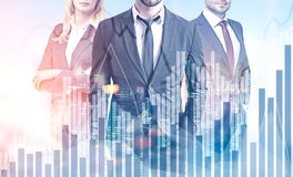 Business team in a city, graphs Royalty Free Stock Photos