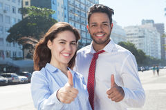 Business team in the city showing thumb up Stock Image