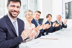 Business team clap in seminar. After successful workshop Stock Photography