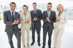 Business team clapping hands together in office Stock Photos