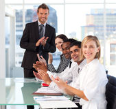 Business team clapping in a meeting Stock Photos