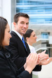 Business Team Clapping at Office Stock Image