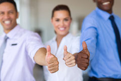 Business team. Close up portrait of business team giving thumbs up Royalty Free Stock Images