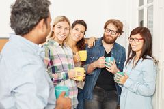 Business team in coffee break. At their office Royalty Free Stock Image