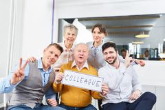 Business team of colleagues with sign royalty free stock photography