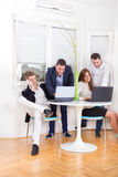 Business team of colleagues smiling working and consulting with Stock Photo