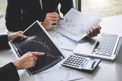 Business team colleagues working with computer, laptop, discussing and analysis graph stock market trading with stock chart data,. Financial and investment royalty free stock image