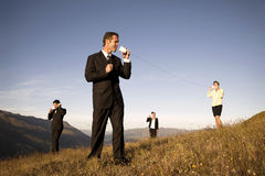 Business Team Communicating Outdoors Concept. Concept of business people communicating globally royalty free stock photo