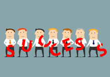 Business team composing word Success. Prosperous business team of smiling businessmen holding red letters in hands and composing the word Success. Successful Royalty Free Stock Image