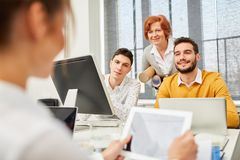 Computer training with tablet and laptop. Business team in computer training with tablet and laptop royalty free stock image