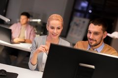 Business team with computer working late at office stock photos