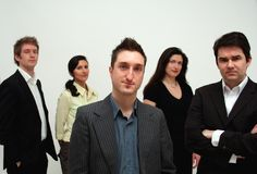Business Team - conceptual leadership. Image of 5 mature business people in both corporate and business casual dress, conceptual leadership stock photos
