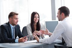 Business team conducts an interview with a young candidate. Royalty Free Stock Photography