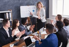 Business team congratulating successful female manager at meeting royalty free stock image