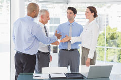 Business team congratulating their colleague Royalty Free Stock Photography