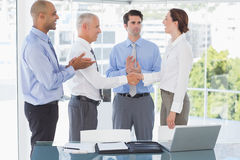 Business team congratulating their colleague Royalty Free Stock Photo
