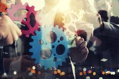 Business team connect pieces of gears. Teamwork, partnership and integration concept. Double exposure. Teamwork of businesspeople work together and combine stock image