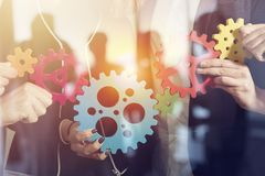 Business team connect pieces of gears. Teamwork, partnership and integration concept. double exposure stock photo