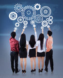 Business team controlling the wheel of business stock photography