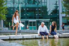 Business team cooling feet in water Stock Image