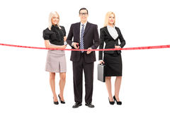 Business team cutting a red tape Royalty Free Stock Image