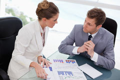 Business team deliberating on market research Stock Images