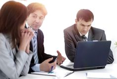 Business team discusses work plan stock photo