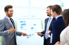 Business team discussing acquisition in meeting royalty free stock photo
