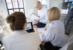 Business team discussing charts at office royalty free stock photo
