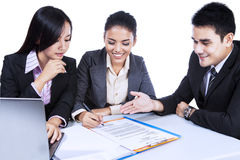 Business Team Discussing A Documents Stock Image