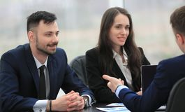 Business team discussing financial documents at your Desk Stock Image