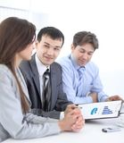 Business team discussing a financial plan Stock Images