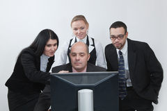 Business team  discussing in front of monitor Stock Image