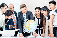 Business team discussing global market intelligence Stock Image