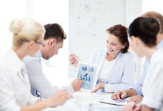 business team discussing graphs in office Stock Photography