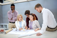 Business team discussing house project at office Royalty Free Stock Photography