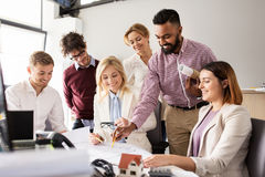 Business team discussing house project at office Royalty Free Stock Image